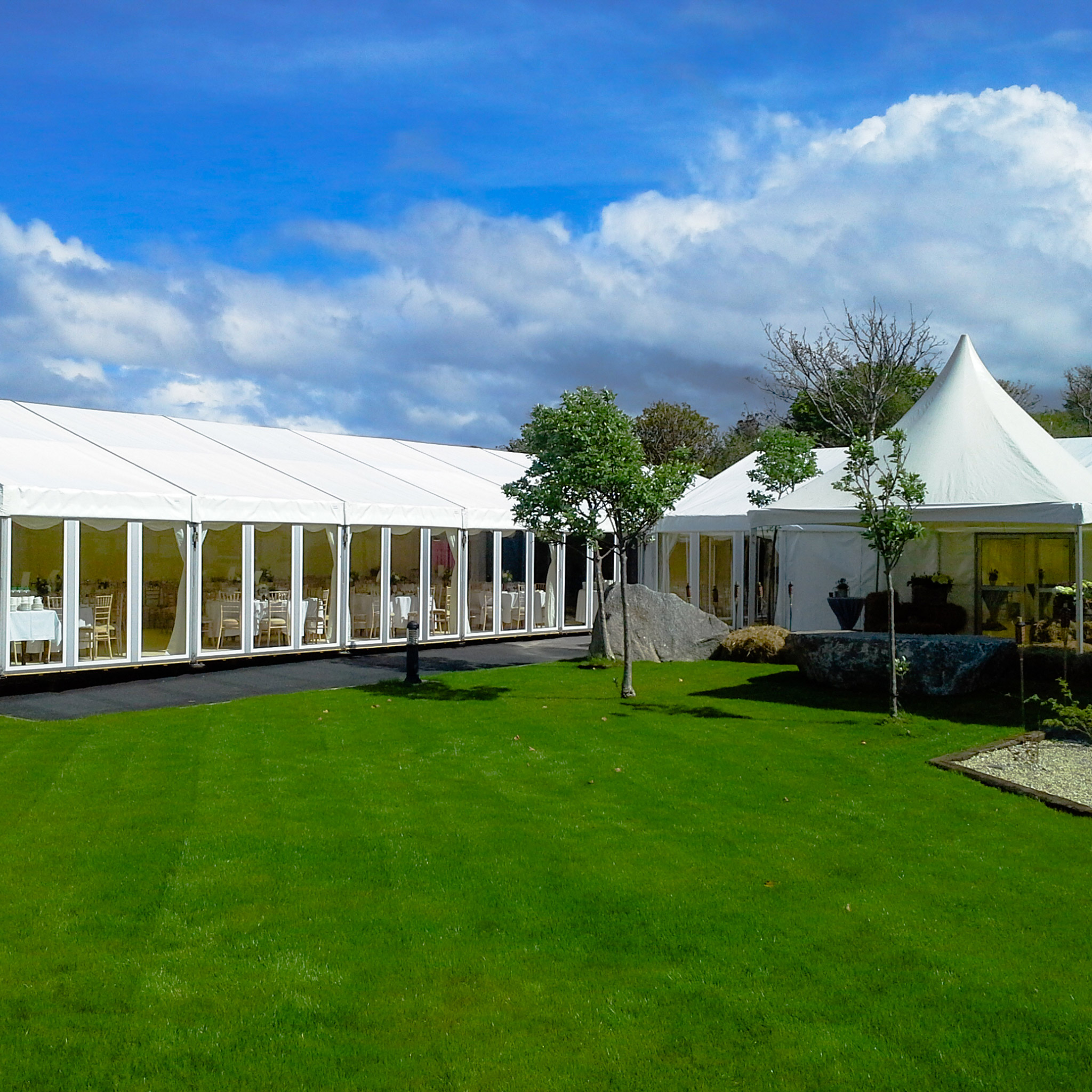 A wedding marquee adjacent to green grass photographed in daylight